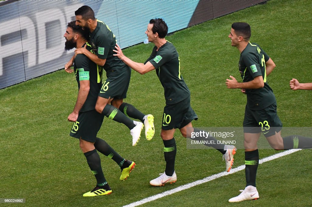 Australia's midfielder Mile Jedinak (L) celebrates with teammates after scoring a penalty kick during the Russia 2018 World Cup Group C football match between Denmark and Australia at the Samara Arena in Samara on June 21, 2018. (Photo by EMMANUEL DUNAND / AFP) / RESTRICTED