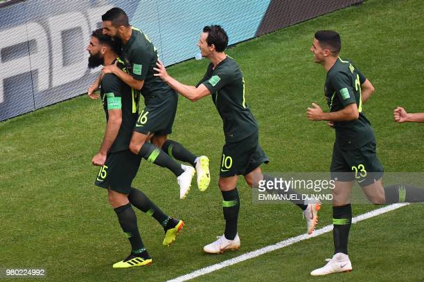 Australia's midfielder Mile Jedinak celebrates with teammates after scoring a penalty kick during the Russia 2018 World Cup Group C football match...