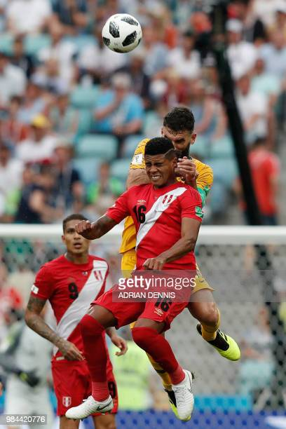 Australia's midfielder Mile Jedinak jumps for the ball with Peru's midfielder Wilder Cartagena during the Russia 2018 World Cup Group C football...