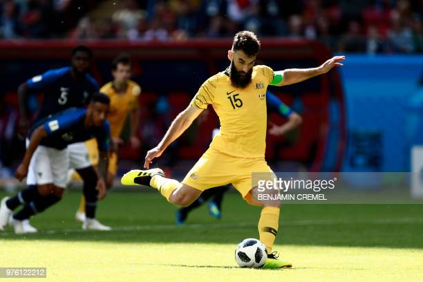 TOPSHOT Australia's midfielder Mile Jedinak takes a penalty kick to score their first goal during the Russia 2018 World Cup Group C football match...