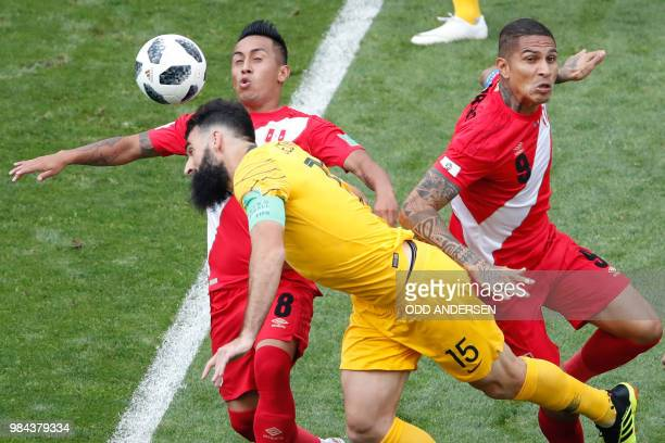 Australia's midfielder Mile Jedinak vies for the ball with Peru's midfielder Christian Cueva and Peru's forward Paolo Guerrero during the Russia 2018...