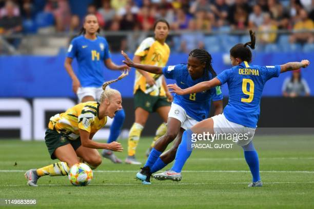 Australia's midfielder Tameka Yallop reacts as she vies with Brazil's midfielder Formiga and Brazil's forward Debinha during the France 2019 Women's...