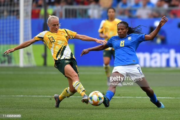 Australia's midfielder Tameka Yallop vies for the ball with Brazil's midfielder Formiga during the France 2019 Women's World Cup Group C football...