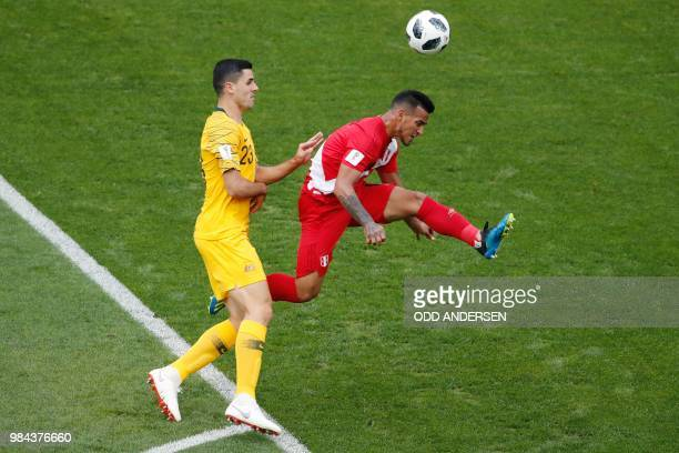 Australia's midfielder Tomas Rogic vies for the ball with Peru's midfielder Christian Cueva during the Russia 2018 World Cup Group C football match...