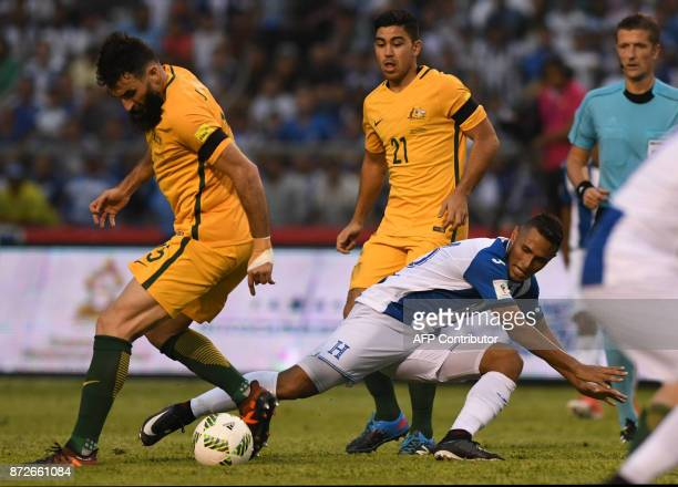 Australia's Mile Jedinak and Honduras' Alex Lopez vie for the ball during the first leg football match of their 2018 World Cup qualifying playoff in...