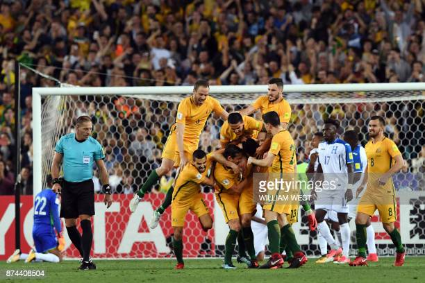 Australia's Mile Jedinak is mobbed by his teammates after scoring against Honduras during their 2018 World Cup qualification playoff football match...