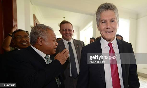 Australia's Minister for Defence Stephen Smith walks next to Indonesia's Minister for Defence Purnomo Yusgiantoro and Australia's Minister for...