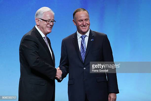 Australia's Minister of Trade and Investment Andrew Robb with New Zealand Prime Minister John Key after signing the Trans Pacific Partnership at Sky...