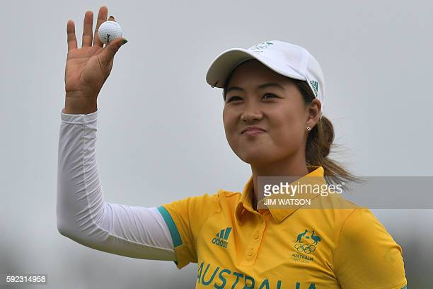 Australia's Minjee Lee finishes her round on 18 in the final day of the Women's individual stroke play at the Olympic Golf course during the Rio 2016...