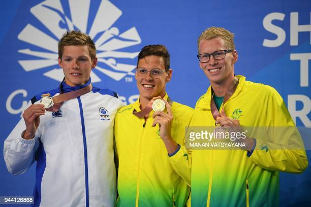 Australia's Mitch Larkin Scotland's Duncan Scott and Australia's Clyde Lewis pose withtheir medals after the swimming men's 200m individual medley...
