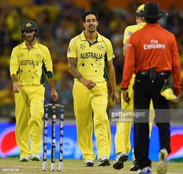 Australia's Mitchell Johnson celebrates taking the wicket of Afghanistan's Usman Ghani during the 2015 Cricket World Cup Pool A match between...