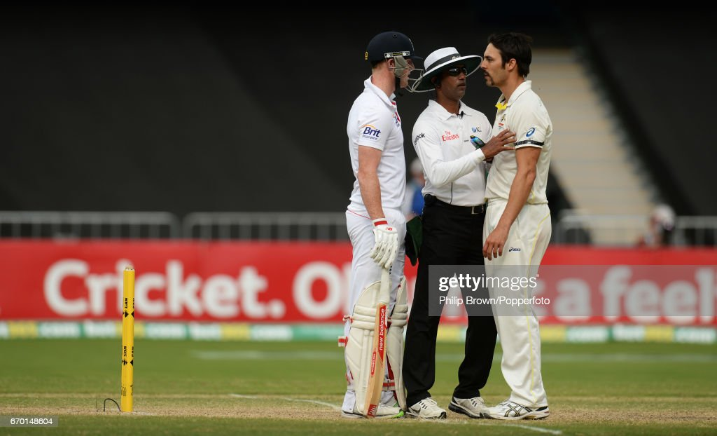 Australia's Mitchell Johnson is held back by umpire Kumar Dharmasena as he talks to England's Ben Stokes (left) during the 2nd Ashes cricket Test match between Australia and England at the Adelaide cricket ground, Adelaide, Australia on the 8th of December 2013.
