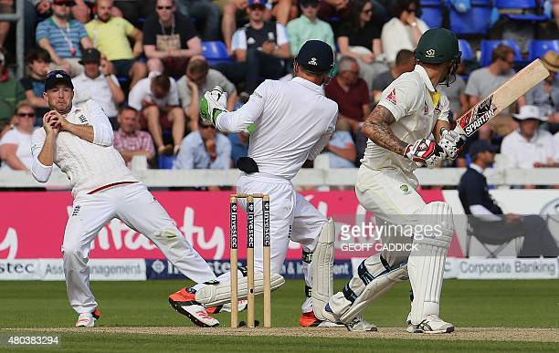 Australia's Mitchell Johnson loses his wicket bowled by Joe Root caught by Adam Lyth on the fourth day of the opening Ashes cricket test match...