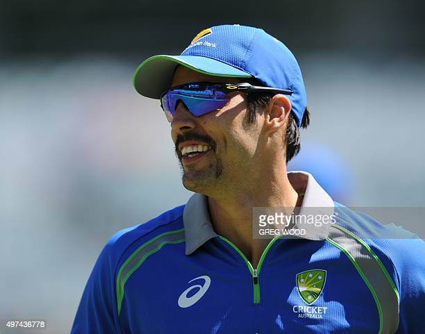Australia's Mitchell Johnson trains with teammates prior to the start of the final day of the second cricket Test match between Australia and New...
