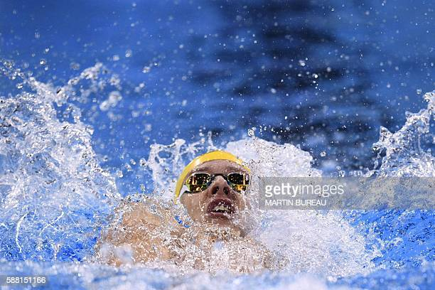 TOPSHOT Australia's Mitchell Larkin competes in a Men's 200m Backstroke heat during the swimming event at the Rio 2016 Olympic Games at the Olympic...