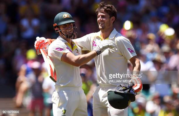 Australia's Mitchell Marsh celebrates scoring his century against England with his teammate and brother Shaun Marsh on the fourth day of the fifth...