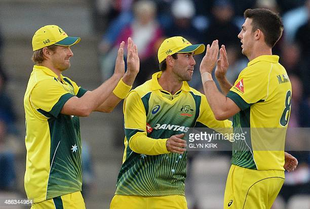Australia's Mitchell Marsh celebrates taking the wicket of England's Alex Hales walks for 22 runs during the first one day international cricket...
