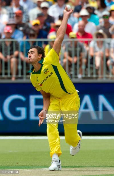 Australia's Mitchell Starc bowls the first delivery at the Optus Perth stadium's inaugural oneday international cricket match between England and...