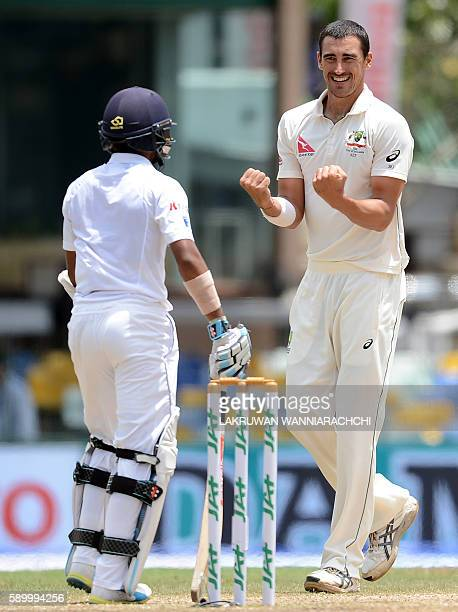 Australia's Mitchell Starc celebrates after he dismissed Sri Lankan batsman Kusal Mendis during the fourth day of the third and final Test cricket...