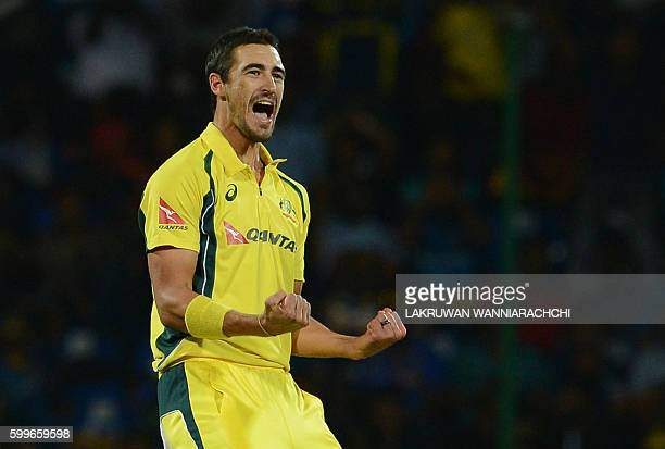 Australia's Mitchell Starc celebrates after he dismissed Sri Lanka's Tillakaratne Dilshan during the first T20 international cricket match between...