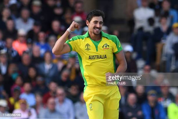 TOPSHOT Australia's Mitchell Starc celebrates after taking his fifth wicket that of West Indies' Sheldon Cottrell during the 2019 Cricket World Cup...