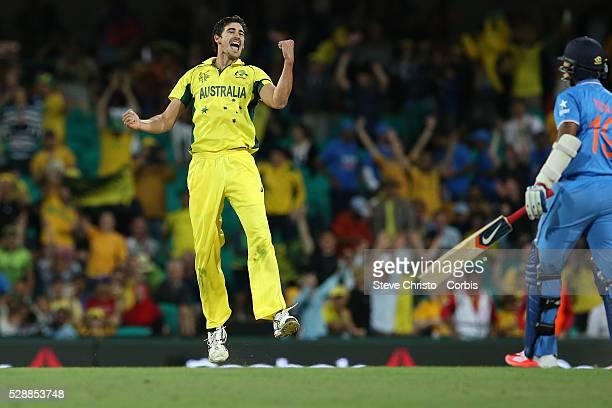 Australia's Mitchell Starc celebrates the last wicket of India's Umesh Yadav to take Australia to the final at the Sydney Cricket Ground Australia...