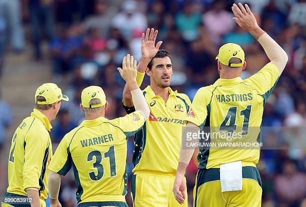 Australia's Mitchell Starc celebrates with his teammates after he dismissed Sri Lanka's Dilruwan Perera during the fifth and final one day...