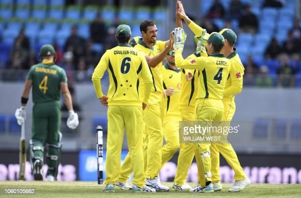 Australia's Mitchell Starc celebrates with teammates after dismissing South Africa's batsman Aiden Markram during their third oneday international...