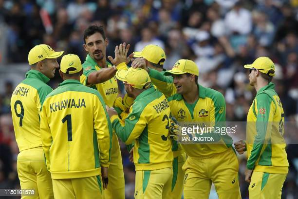 Australia's Mitchell Starc celebrates with teammates after taking the wicket of Sri Lanka's Thisara Perera for seven during the 2019 Cricket World...