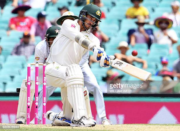 Australia's Mitchell Starc hits a shot against Pakistan during the second day of the third cricket Test match at the SCG in Sydney on January 4 2017...