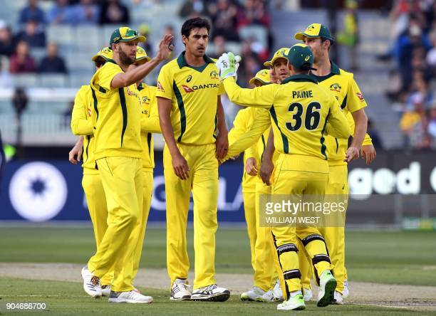Australia's Mitchell Starc is congratulated by teammates after dismissing England batsman Jonny Bairstow during their oneday international cricket...