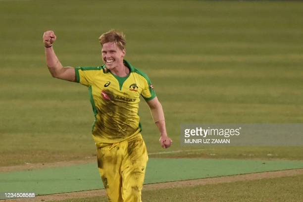 Australia's Nathan Ellis celebrates after taking a wicket during third Twenty20 international cricket match between Bangladesh and Australia at the...
