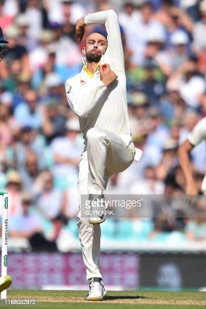 Australia's Nathan Lyon bowls during play on the third day of the fifth Ashes cricket Test match between England and Australia at The Oval in London...