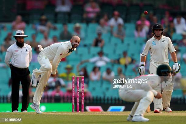 Australias Nathan Lyon bowls during the second day of the third cricket Test match between Australia and New Zealand at the Sydney Cricket Ground in...