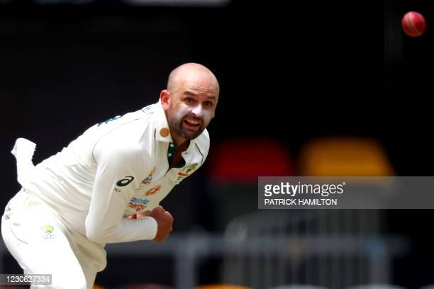 Australia's Nathan Lyon bowls on day three of the fourth cricket Test match between Australia and India at the Gabba in Brisbane on January 17, 2021....