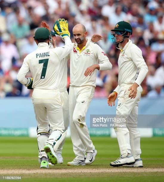 Australia's Nathan Lyon celebrates bowling out England's Moeen Ali during day three of the Ashes Test match at Edgbaston, Birmingham.