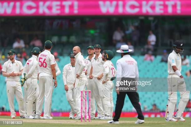 Australias Nathan Lyon celebrates with his teammates after dismissing New Zealand's Jeet Raval during the fourth day of the third cricket Test match...