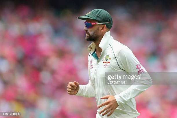Australias Nathan Lyon chases the ball during the third day of the third cricket Test match between Australia and New Zealand at the Sydney Cricket...