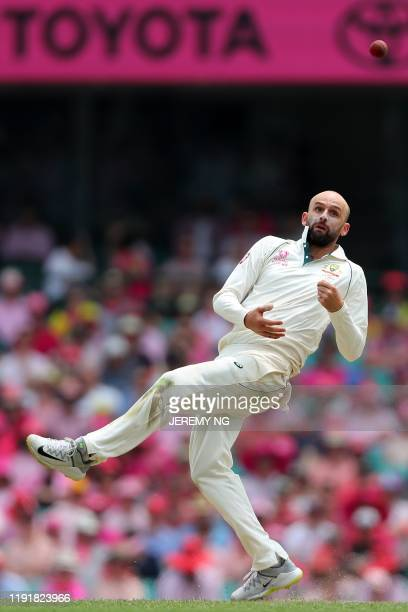 Australia's Nathan Lyon drops a return catch during the third day of the third cricket Test match between Australia and New Zealand at the Sydney...