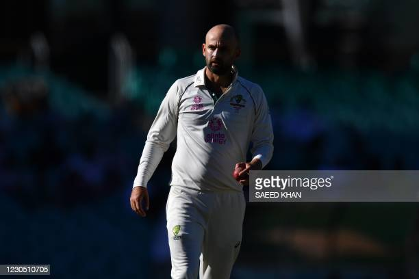 Australia's Nathan Lyon prepares to bowl on the fourth day of the third cricket Test match between Australia and India at the Sydney Cricket Ground...