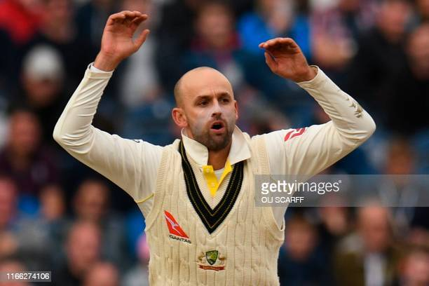 Australia's Nathan Lyon reacts bowling on the third day of the fourth Ashes cricket Test match between England and Australia at Old Trafford in...