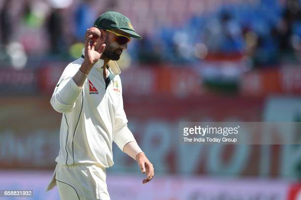 Australias Nathan Lyon shows the ball to spectators as he celebrates his five wicket haul in Indias first innings during the 3rd day of their fourth...