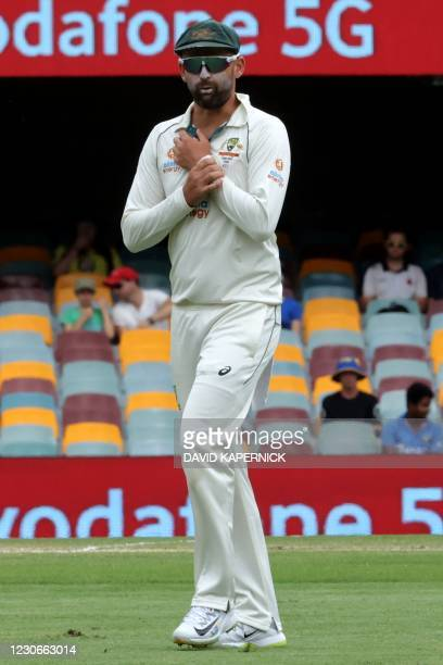 Australia's Nathan Lyon walks back to his fielding position on day five of the fourth cricket Test match between Australia and India at The Gabba in...