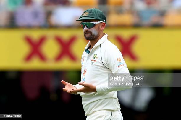 Australia's Nathan Lyon walks back to his fielding position on day two of the fourth cricket Test match between Australia and India at the Gabba in...