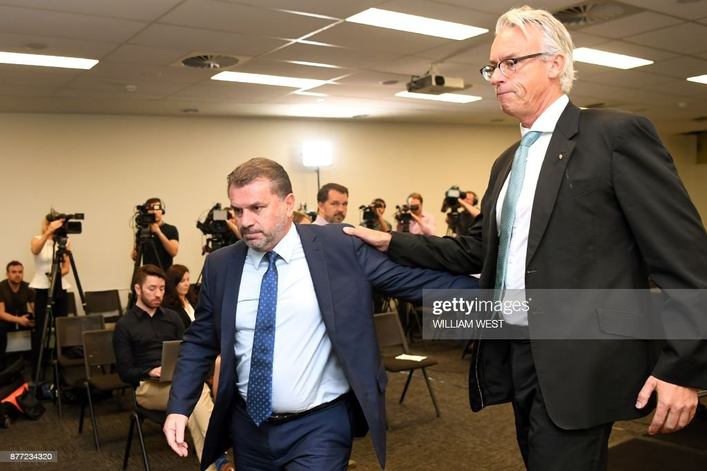 Australia's national football coach Ange Postecoglou leaves a press conference with Football Federation of Australia (FFA) chief David Gallop (R) after announcing his resignation in Sydney on November 22, 2017. An emotional Ange Postecoglou said on November 22 he will not take Australia to the World Cup next year after a lengthy qualification campaign, leaving the team just months to find a new coach for Russia. / AFP PHOTO / William WEST