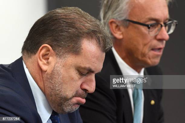 Australia's national football coach Ange Postecoglou reacts beside Football Federation of Australia chief David Gallop during a press conference to...
