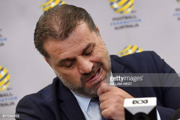 Australia's national football coach Ange Postecoglou reacts during a press conference after announcing his resignation in Sydney on November 22 2017...