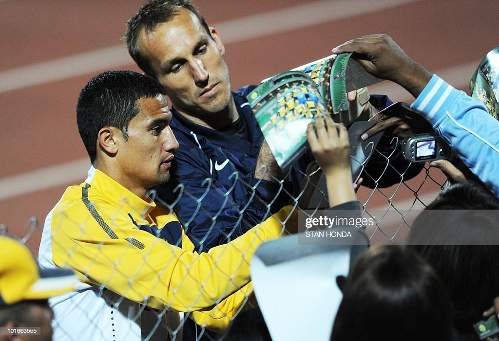 Australia's national football team's striker Tim Cahill (L) and goalkeeper Mark Schwarzer sign autographs after a team training session ahead of the start of the 2010 World Cup on June 6, 2010 in Roodepoort.