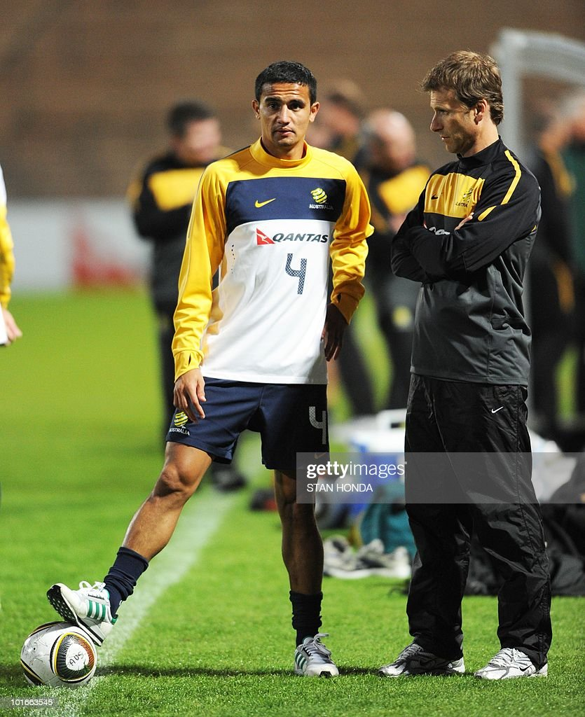 Australia's national football team's striker Tim Cahill (L) chats with a team mate during a team training session ahead of the start of the 2010 World Cup on June 6, 2010 in Roodepoort.