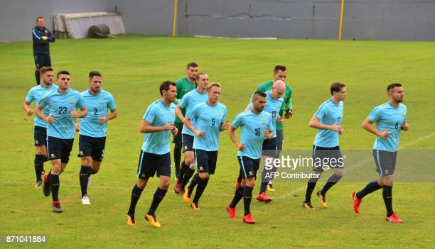 Australia's national team footballers jog during a training session at Francisco Morazan stadium in San Pedro Sula 180 kilometres north of...